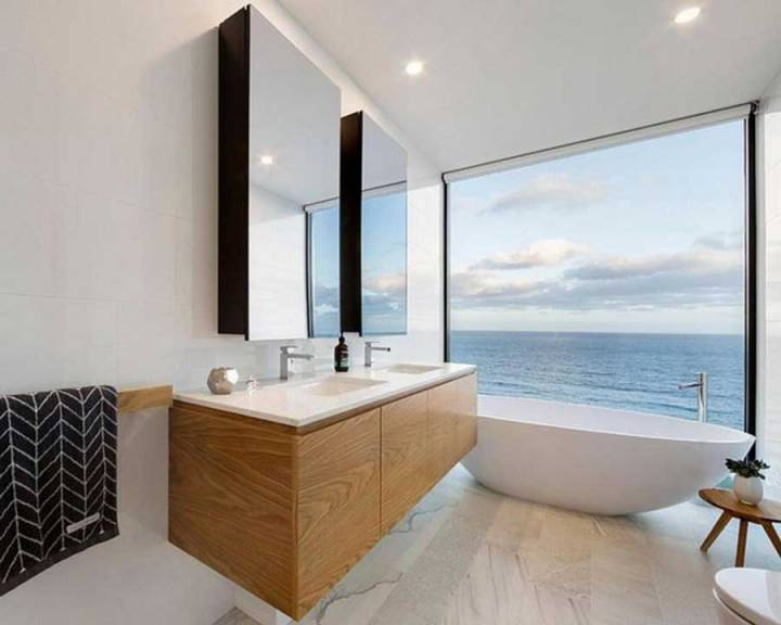 The bathroom has a beautiful view of the sea