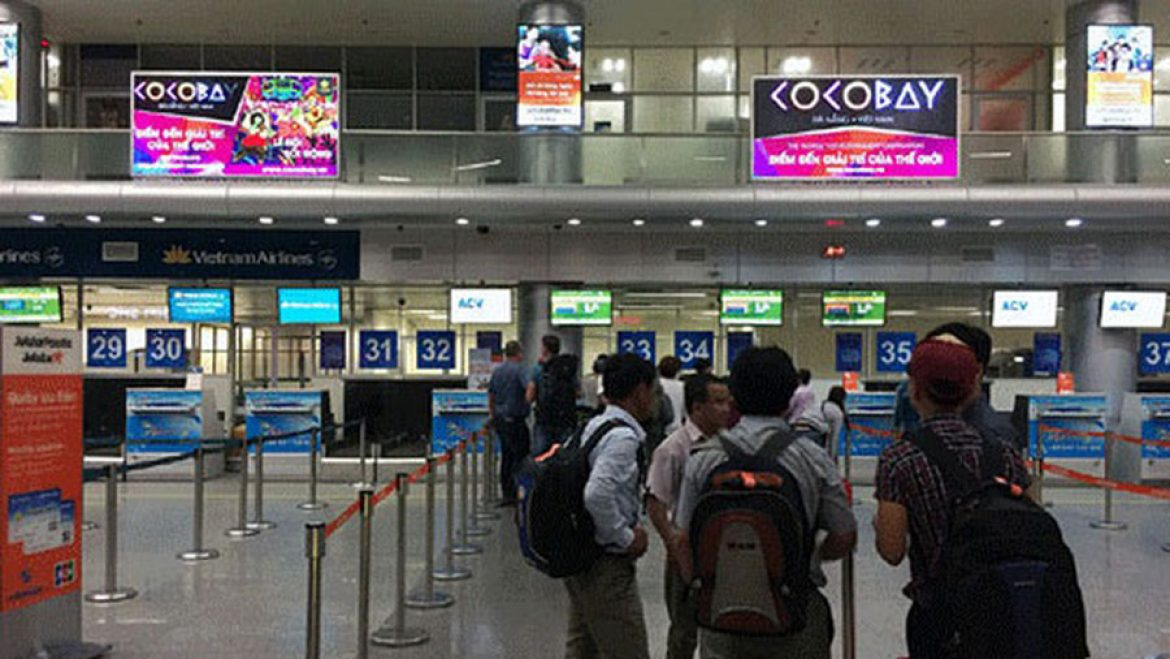 A corner of the check-in at Danang airport with Cocobay advertising panels