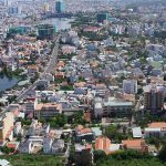 How do land prices in the provinces around HCMC change in 2017?