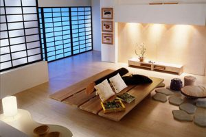 The living room is designed with natural lighted windows and delicate wood furniture