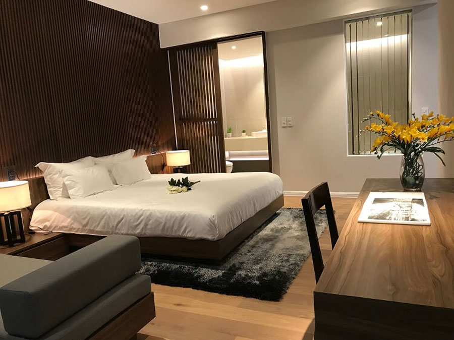 The bedroom area is fitted with high quality wooden flooring