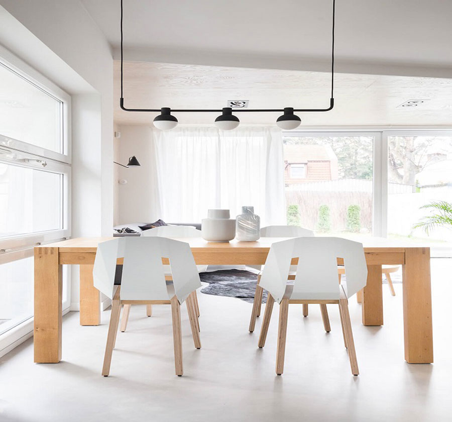 The dining table is designed with raw materials and carpentry, but still shows the modern